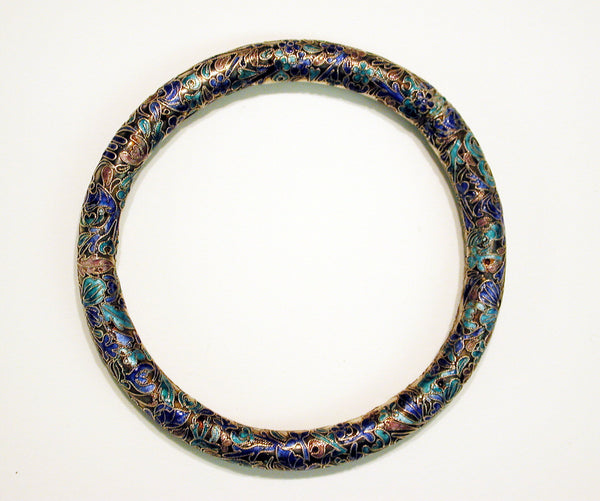 An example of a cloisonné bangle in shades of blue, orange, and pink. (Arthur M. Sackler Gallery, Smithsonian Institution)