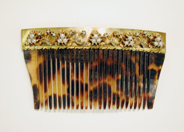 Tortoise shell hair comb with gold and pearl decoration. (Freer Sackler Gallery)