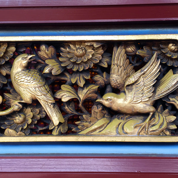 Birds frolic among plants on a gilt door panel. (Christine Lin/Yun Boutique)