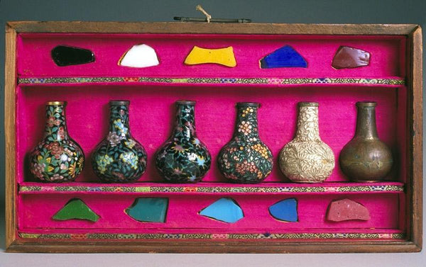 "A set of small vases used to demonstrate the materials and process of making cloisonné. ""Read"" the vases from right to left. (Asian Art Museum)"