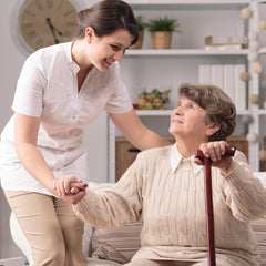 Care home worker assisting patient