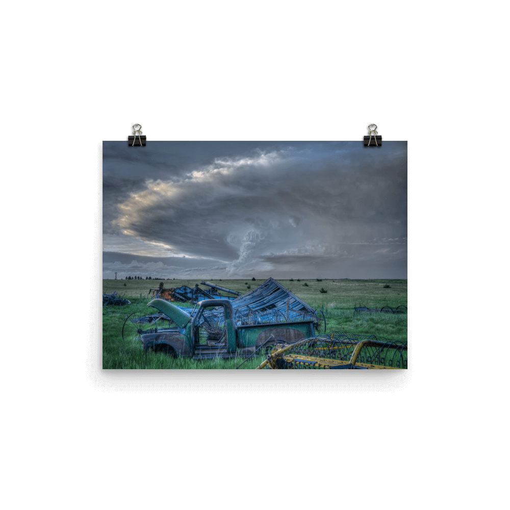 Storm and old truck at sunset