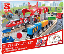 Load image into Gallery viewer, Hape Busy City Train Rail Set Complete City Themed Wooden Rail Toy Set for Toddlers with Passenger Train, Freight Train, Station, Play Figurines, and More