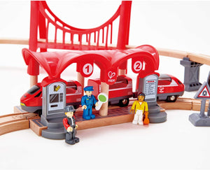 Hape Busy City Train Rail Set Complete City Themed Wooden Rail Toy Set for Toddlers with Passenger Train, Freight Train, Station, Play Figurines, and More