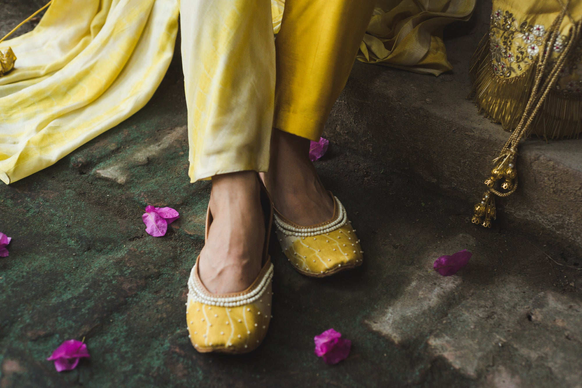 Yellow Tye and dye Juttis Embellished with Pearls and Embroidery