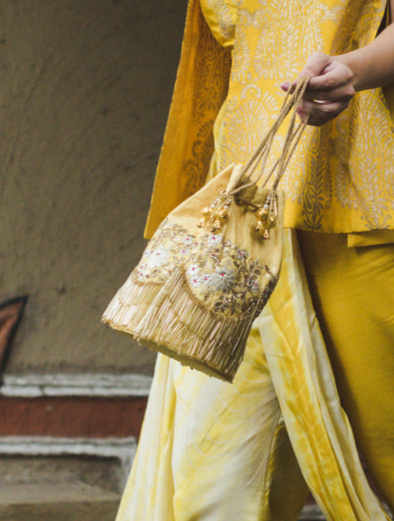 Deep Yellow Potli Handbag Handcrafted in Leather & Embellished with Tassels