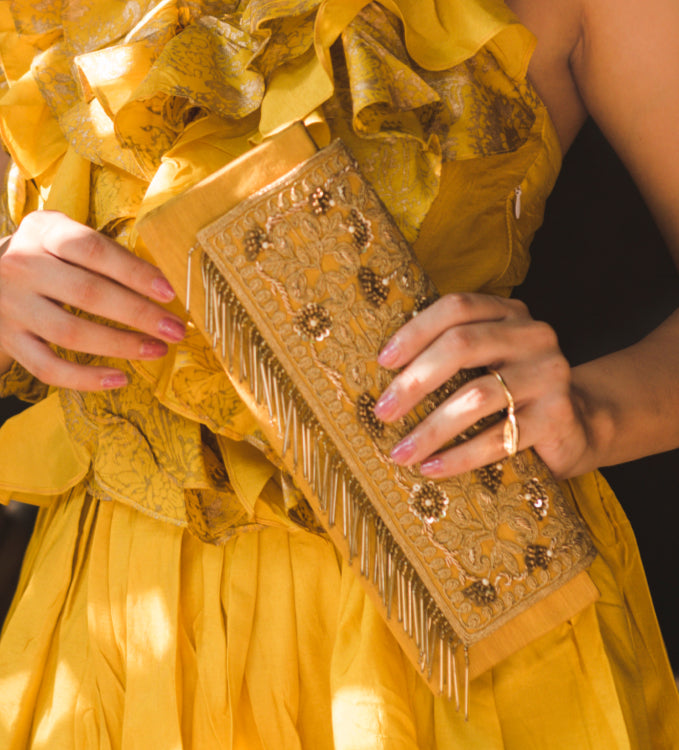 Deep Yellow Clutch Handbag with string Curated with Tassels & Pearls