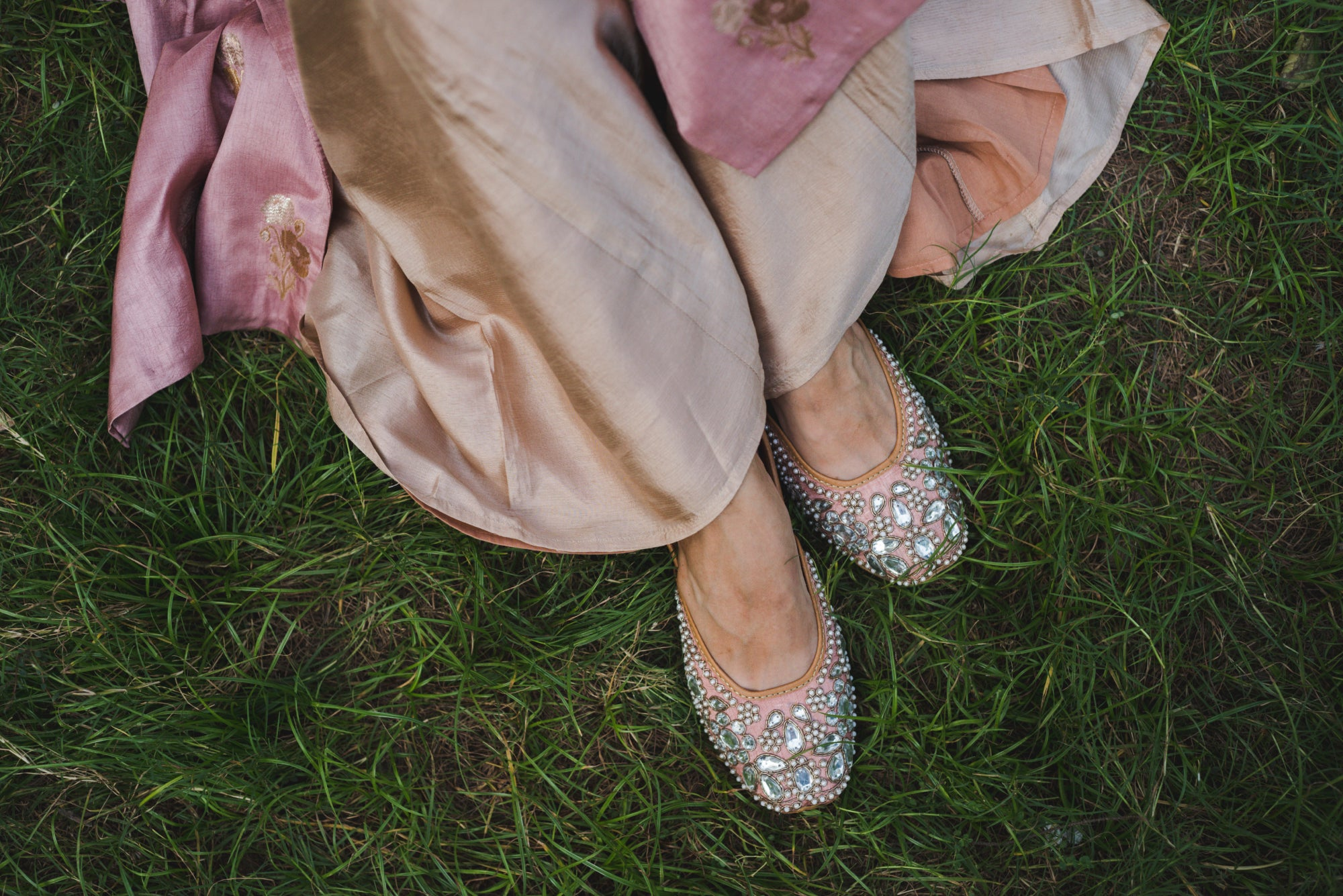 Soft Pink Leather Juttis in Intricate Mirror Work & Hand Embroidery