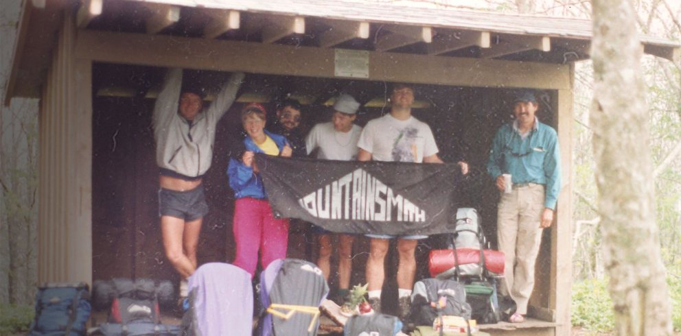 Team holding Mountainsmith banner - 40 Years of Innovation