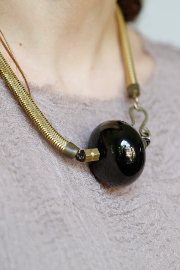 Black Disc on Vintage Chain