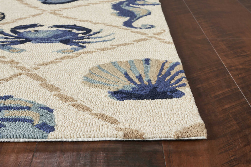 "7'6"" x 9'6"" UV-treated Polypropylene Sand Area Rug"