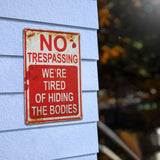 Retro Funny Metal Sign NO TRESSPASSING WE'RE TIRED OF HIDING THE BODIES Halloween Decorations Wall Decor Art