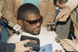 80s NFL player Lawrence Taylor wearing sunglasses
