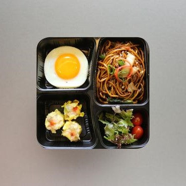 Stir-fried Noodles served with Fried Egg & Chicken Siew Mai