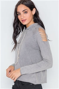 Image of a grey stonewash hoodie with laser cutouts on the shoulder to create a distressed look.
