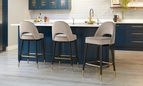The Clover bar stool is a great choice for transforming a kitchen island into an extra social space.