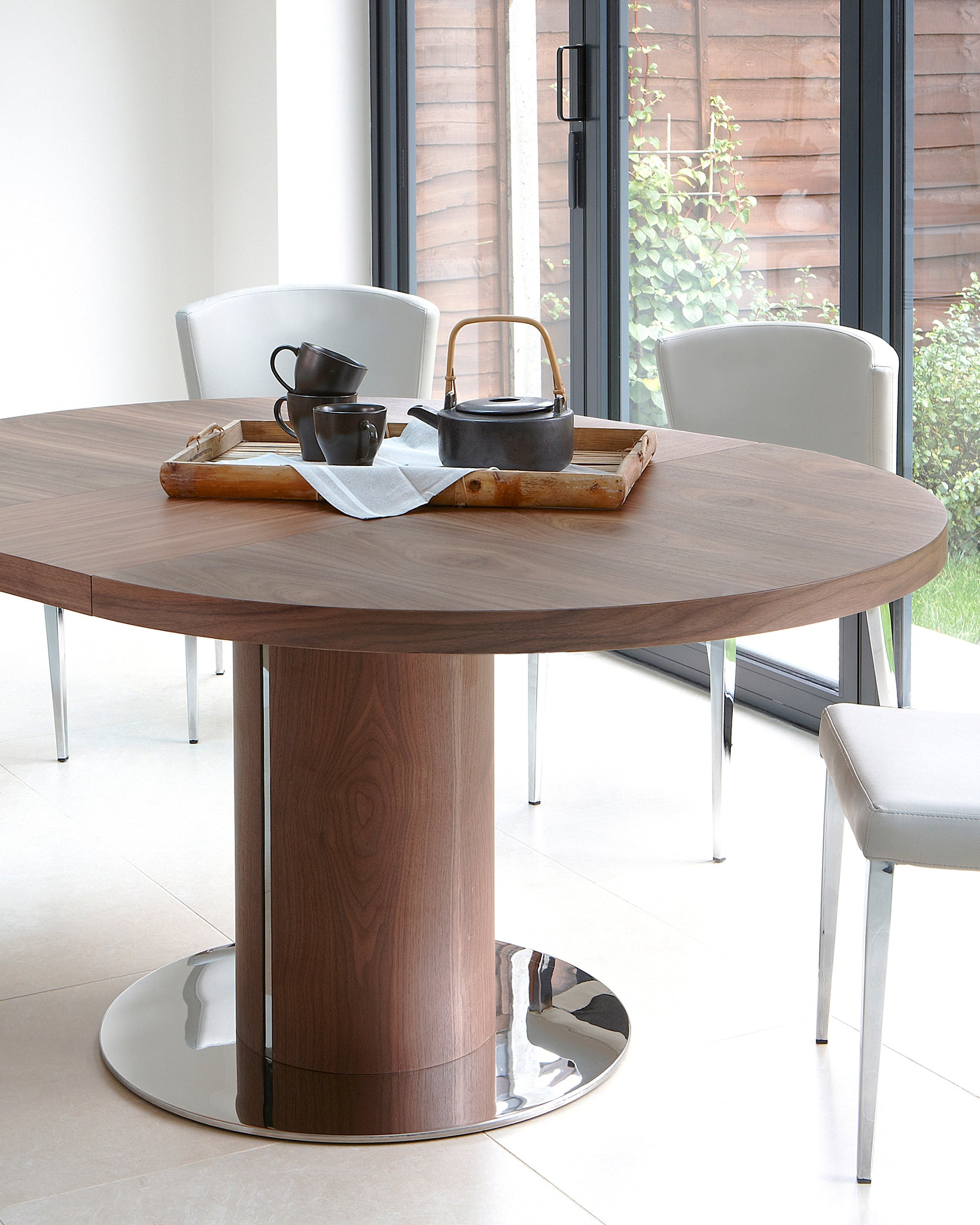 Curva Walnut Round Extending Dining Table