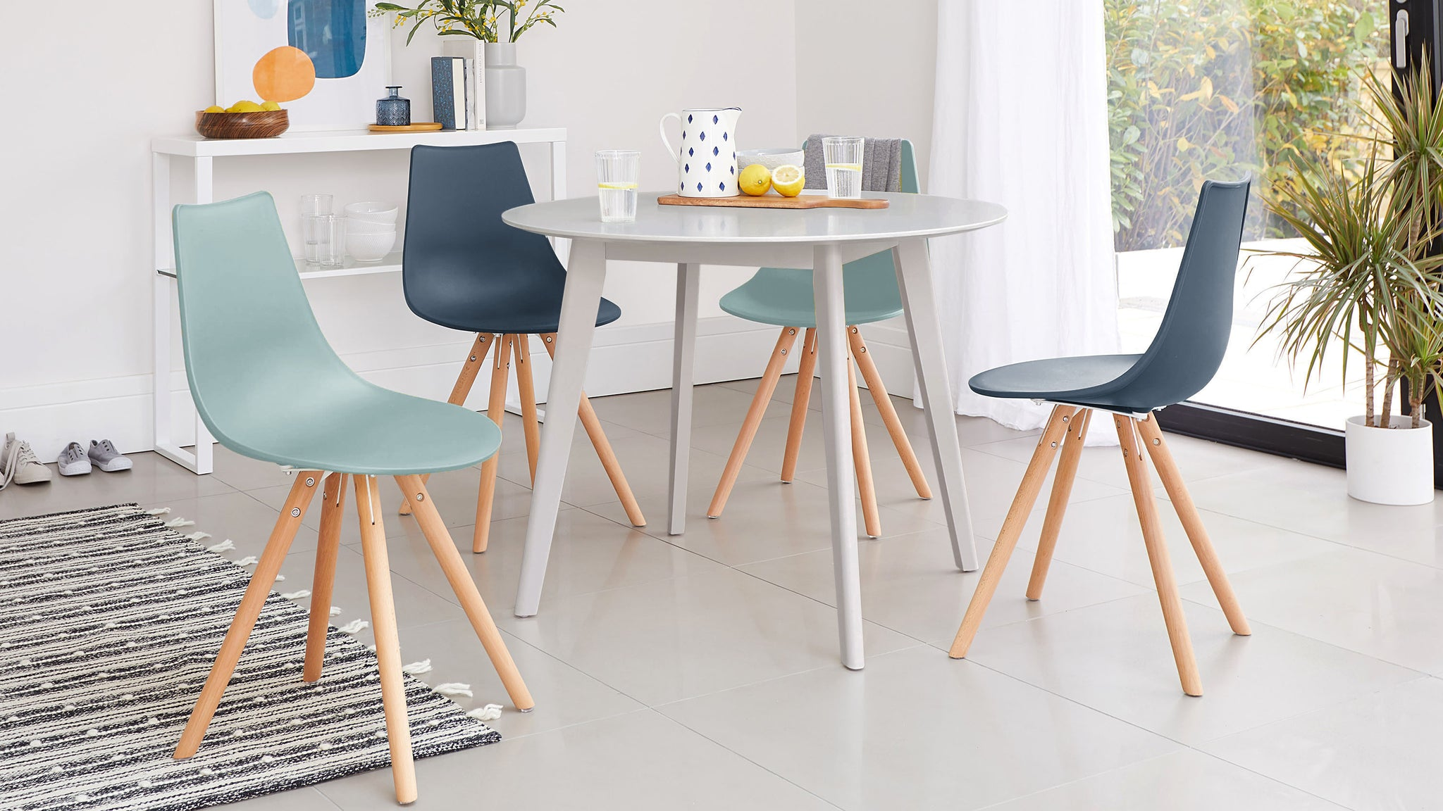 Terni Round Grey Table And Finn Dining Set