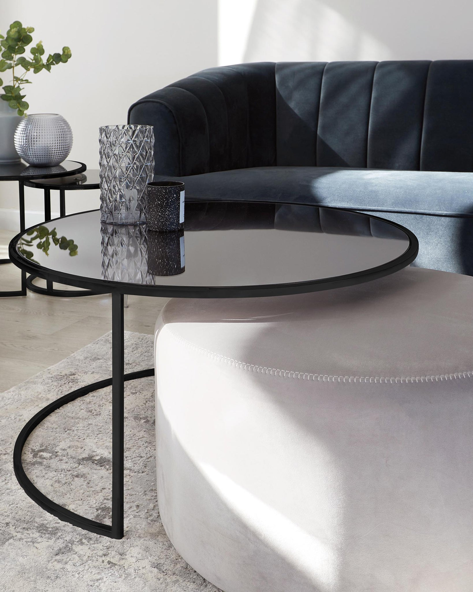 Thea Black Round Coffee Table and Light Grey Pouffe Set