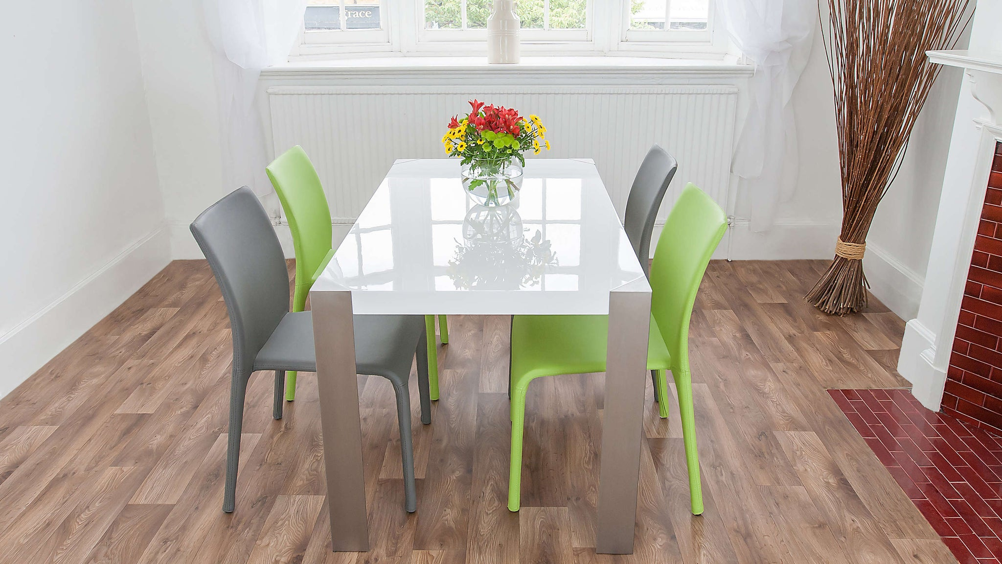 Stylish White Dining Table and Coloured Leather Dining Chairs