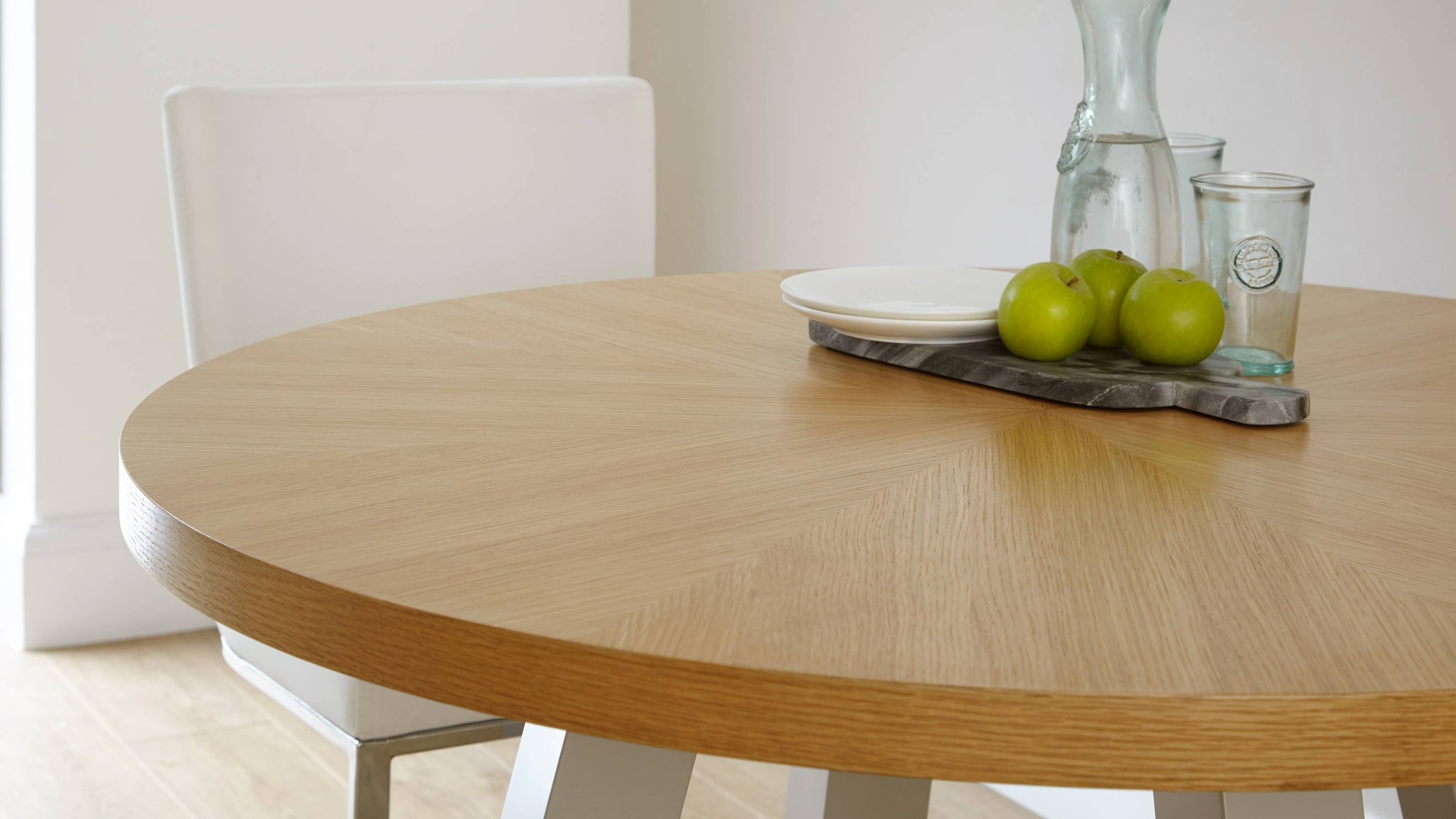 Wood veneer round four seater dining table Exclusively Danetti with Julia Kendell Range
