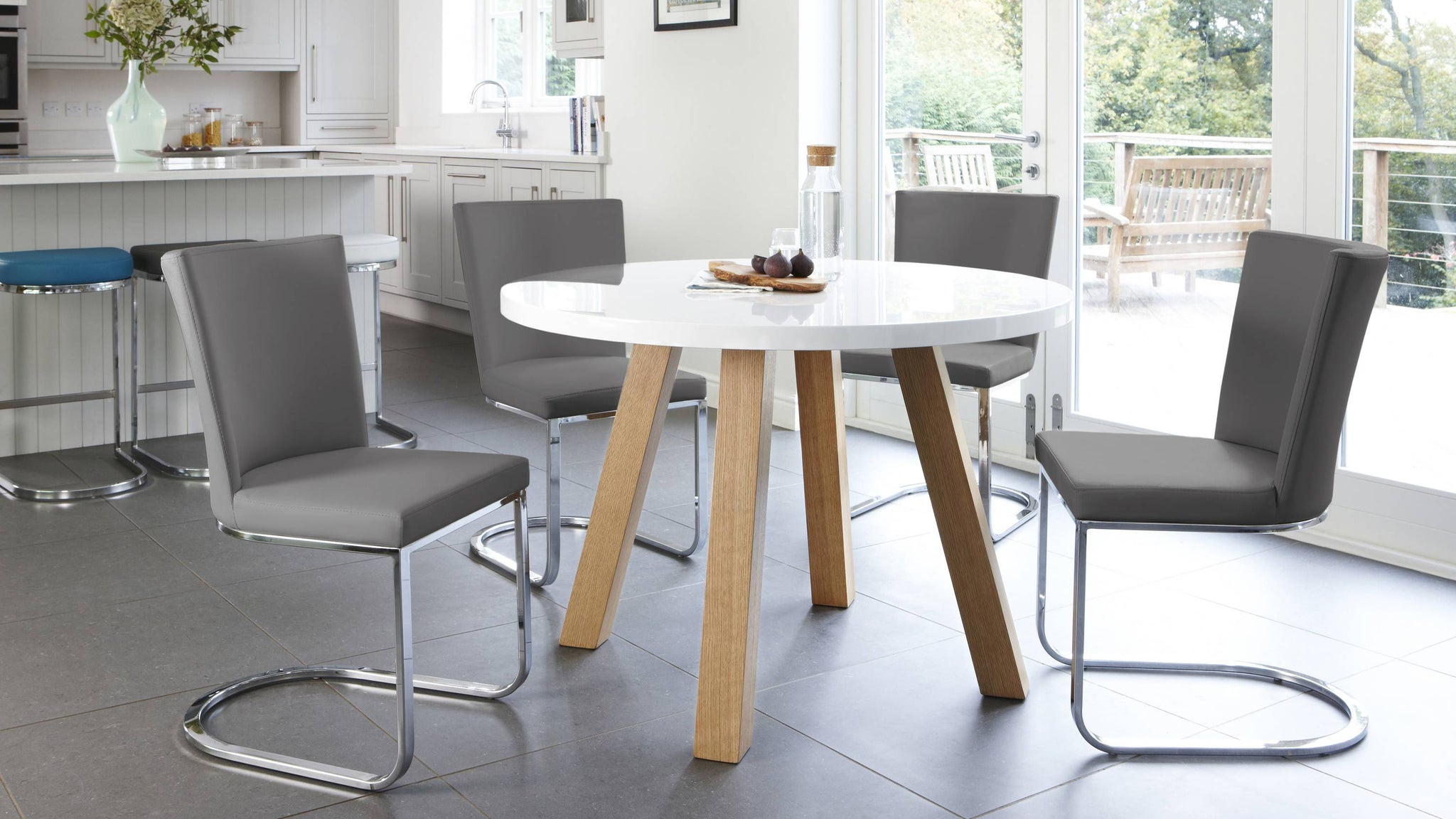 Modern four seater white gloss dining table with oak legs