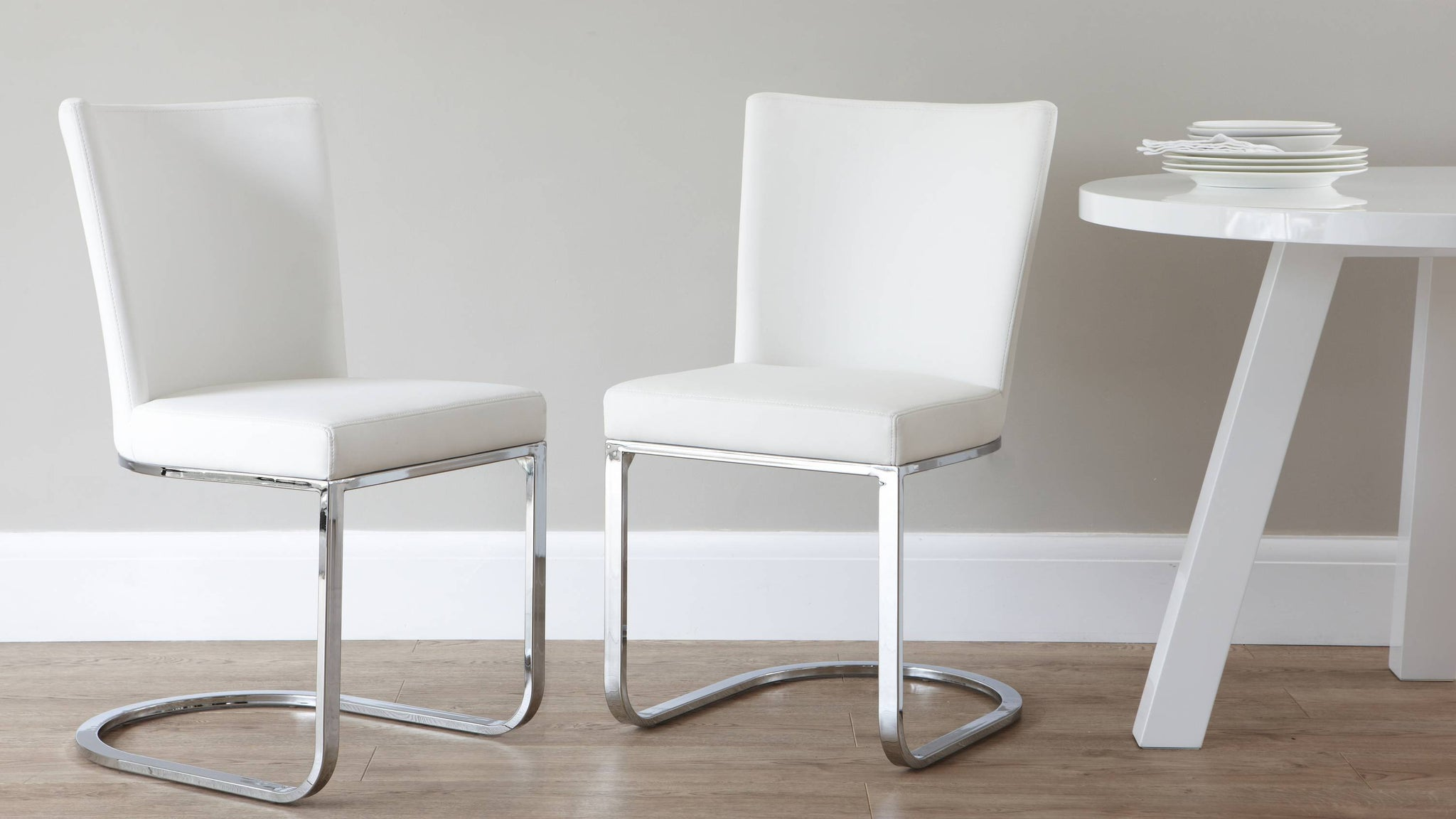 Faux white leather dining chairs