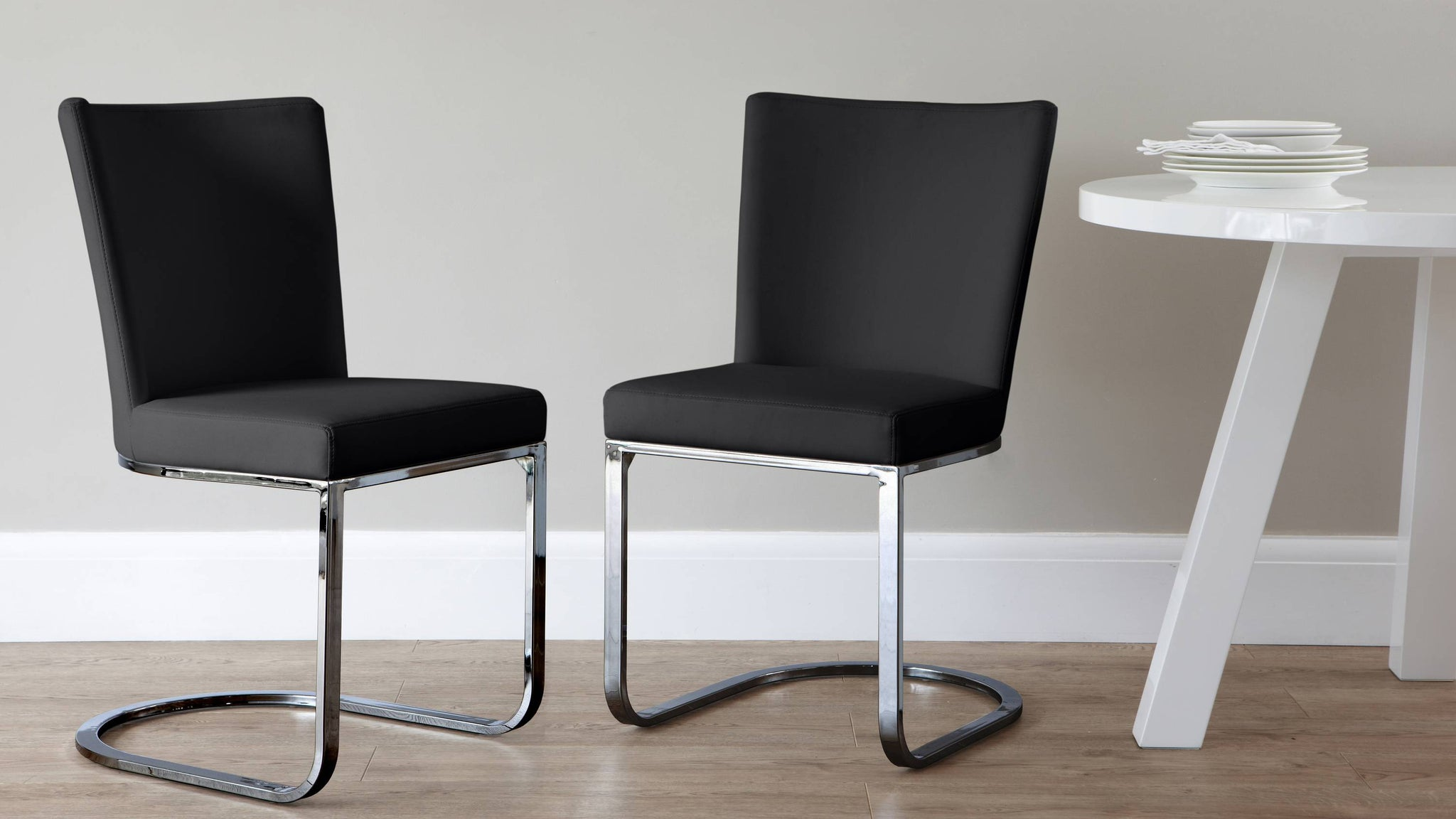 Black dining chairs with chrome frame