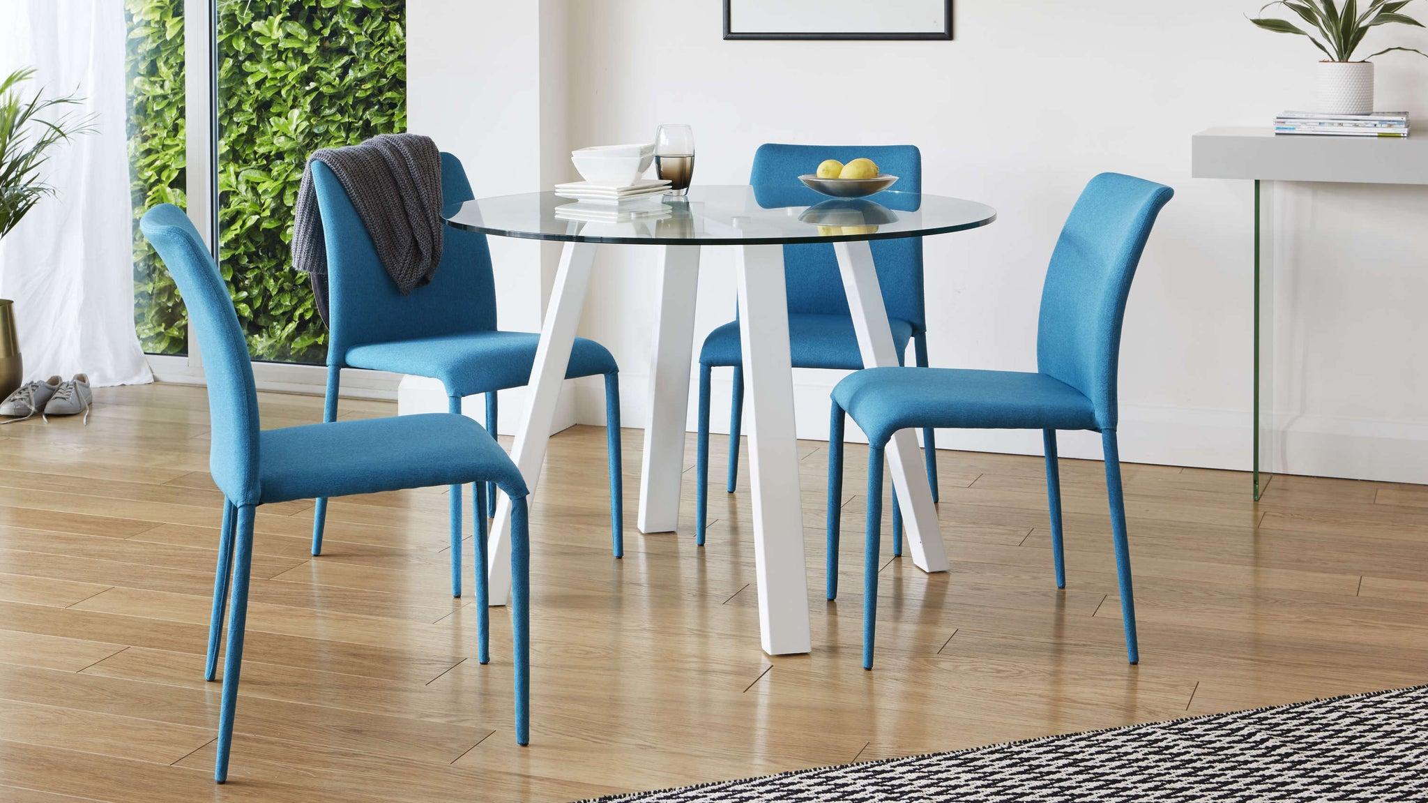 Bright fabric chair and glass table dining set