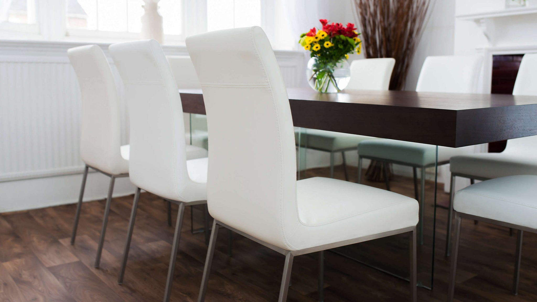 Strong Glass Based Dining Table with Modern White Dining Chairs