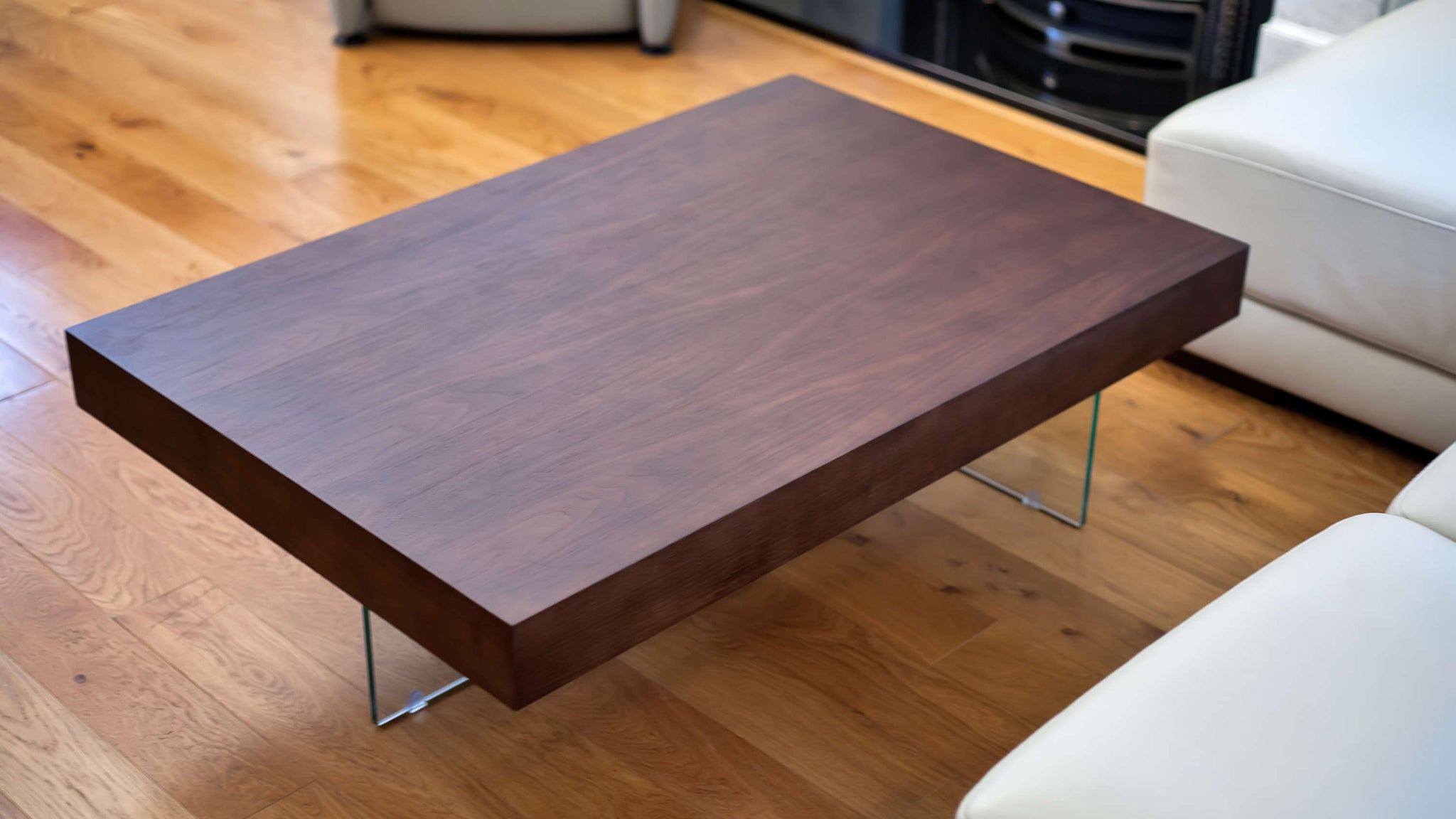 rectangular wood veneer table with two glass legs