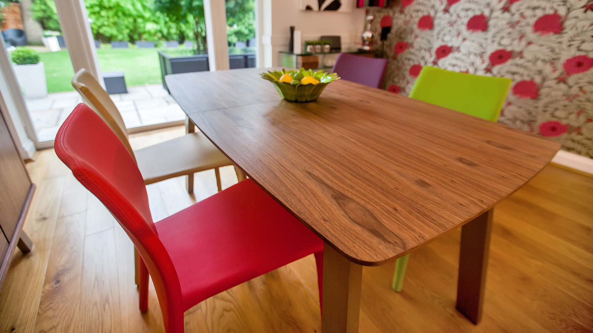 Colourful Dining Chairs and Walnut Extending Dining Table