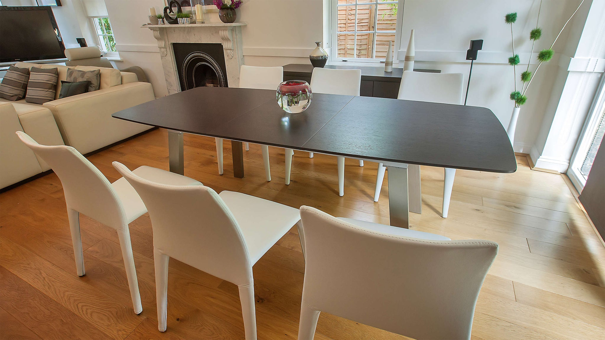 Stylish Wenge 6-8 Seater Extending Dining Table and Stackable Faux Leather Dining Chairs