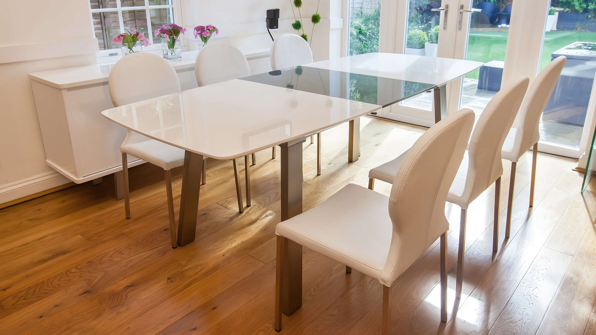 6-8 Seater White Gloss Extending Table and White Dining Chairs