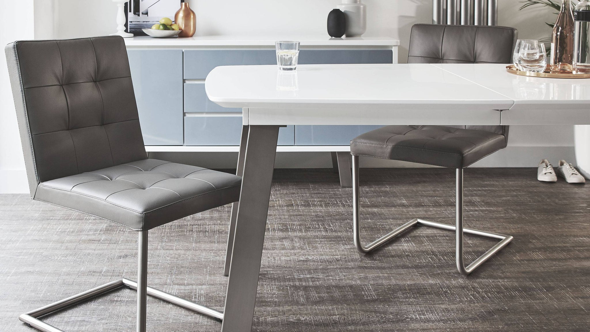 Brushed steel extending dining table