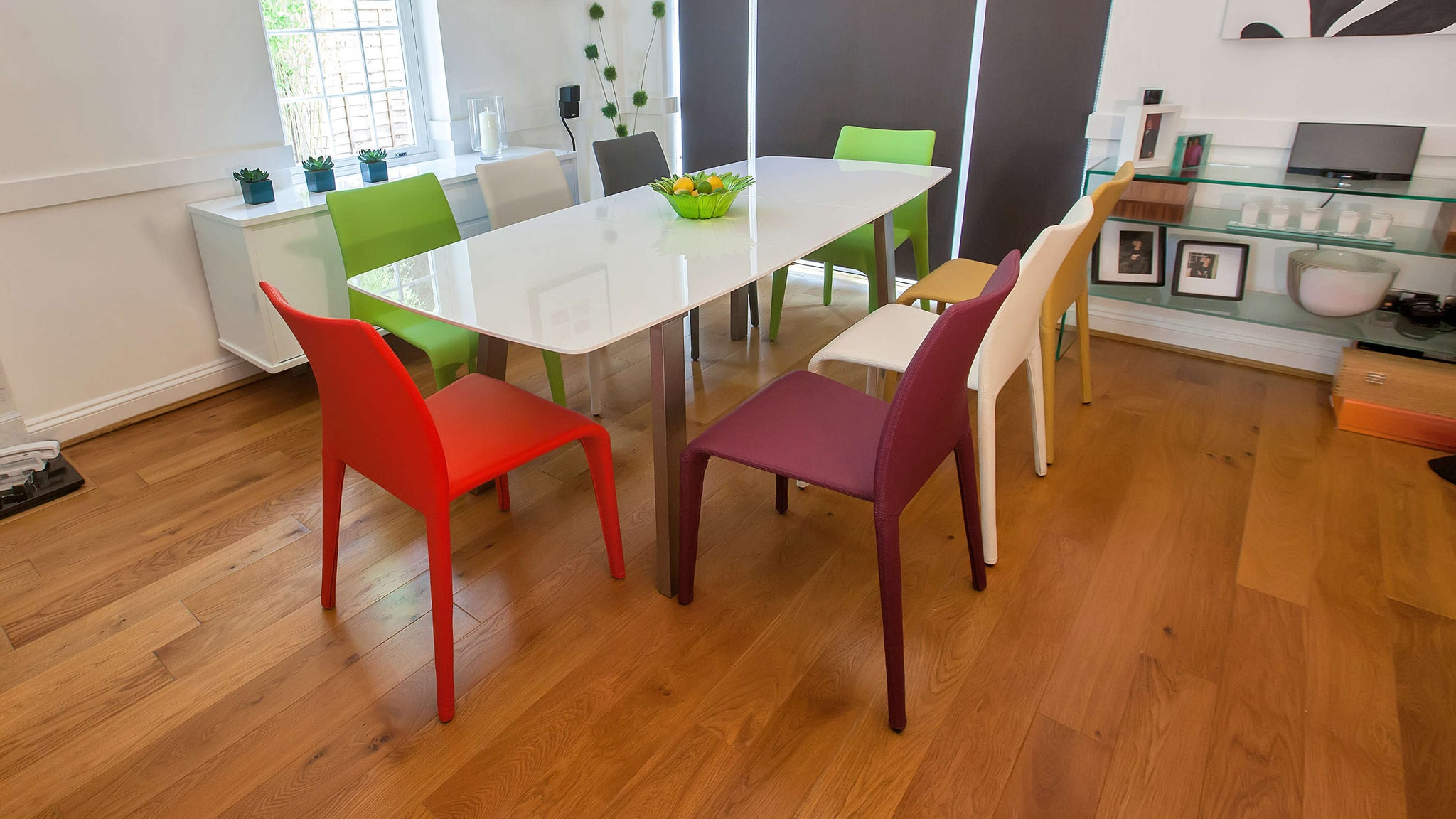 Colourful Dining Chairs and White Gloss Extending Dining Table