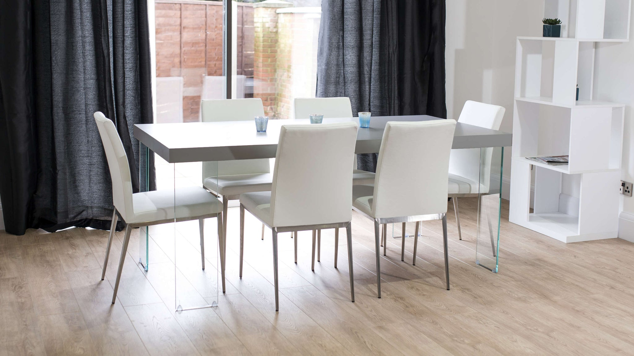 Modern Floating Dining Table and Faux Leather Dining Chairs