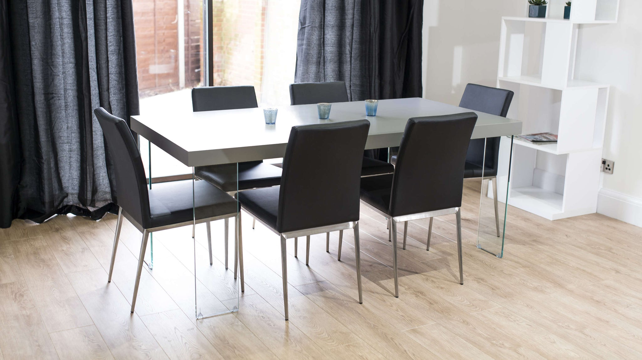 4-6 Seater Glass Based Dining Table with Black Dining Chairs