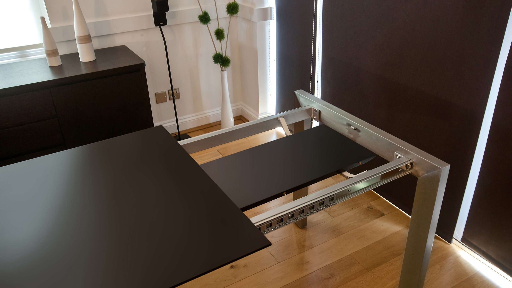 Matt Black Dining Table with Extension Leaf Storage