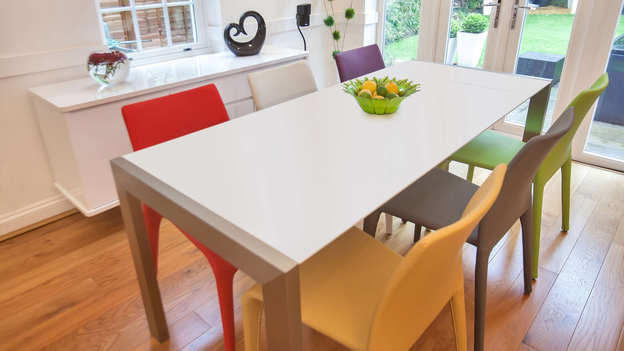 Colourful Dining Chairs and White Double Extending Dining Table
