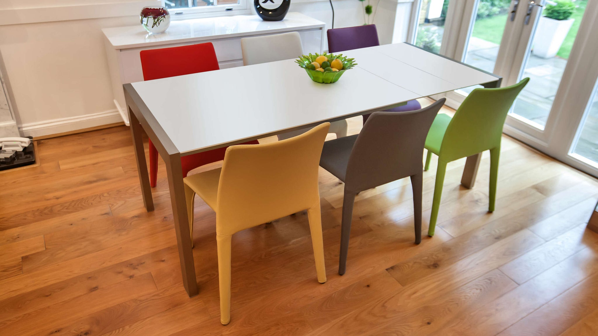 Coloured Dining Chairs and Matt White Extending Dining Table
