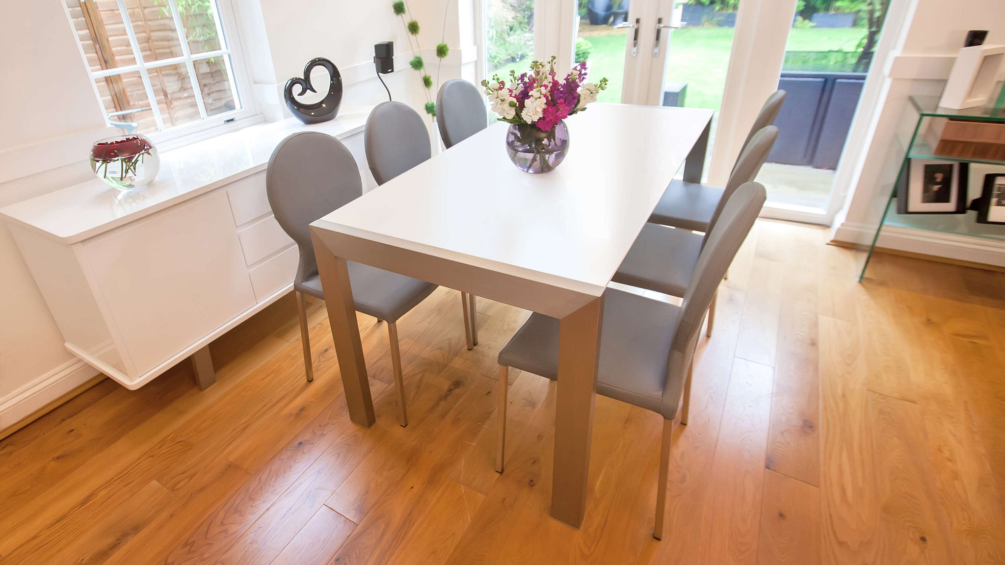 4-8 Seater Dining Table and Grey Faux Leather Dining Chairs