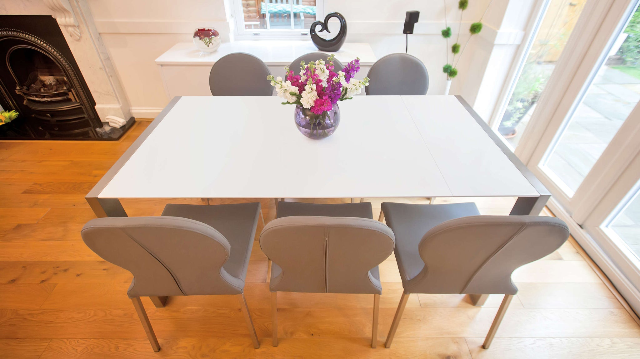 Contemporary Grey Dining Chairs and White Dining Table