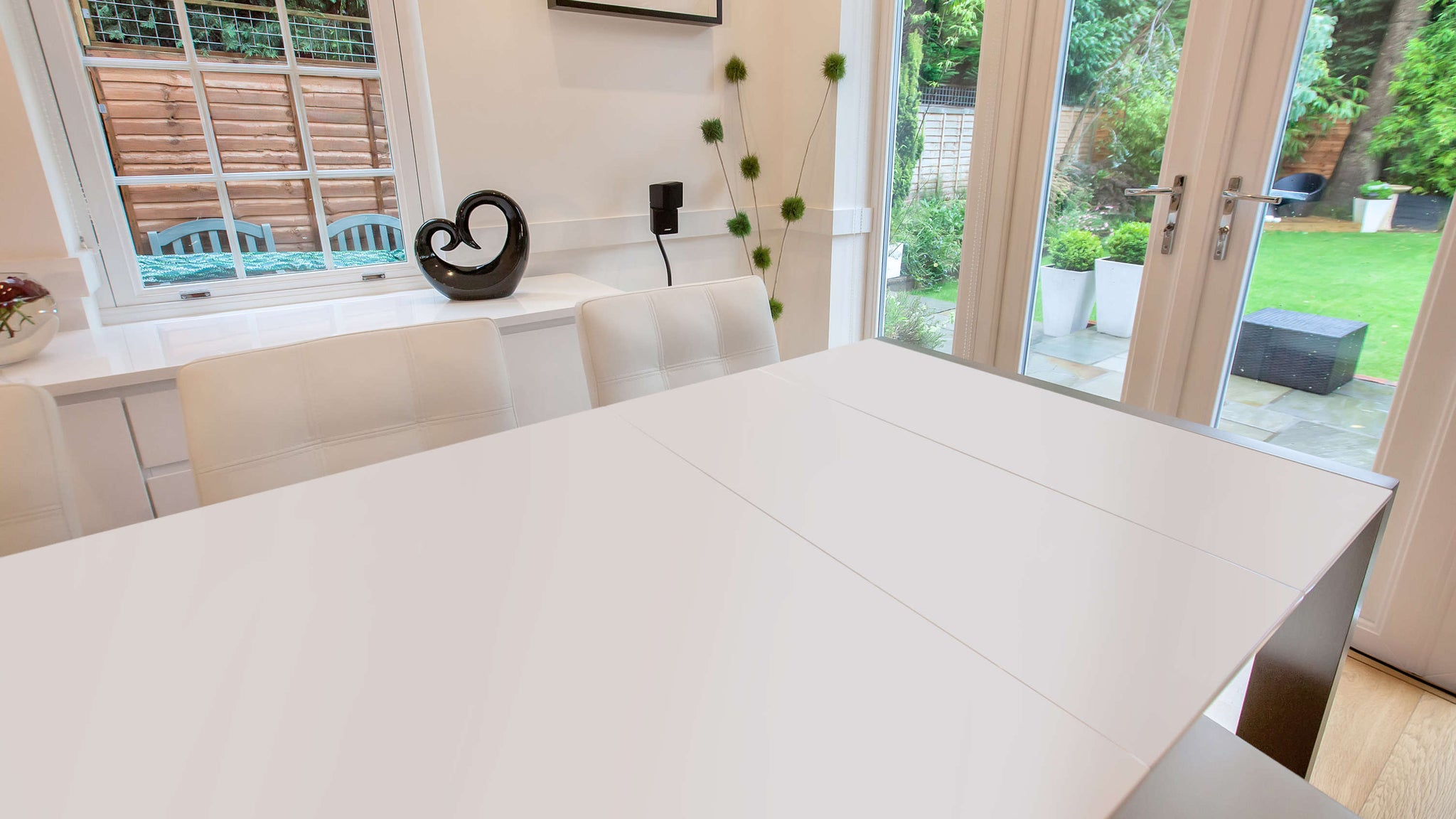 Large White Extending Dining Table and White Dining Chairs