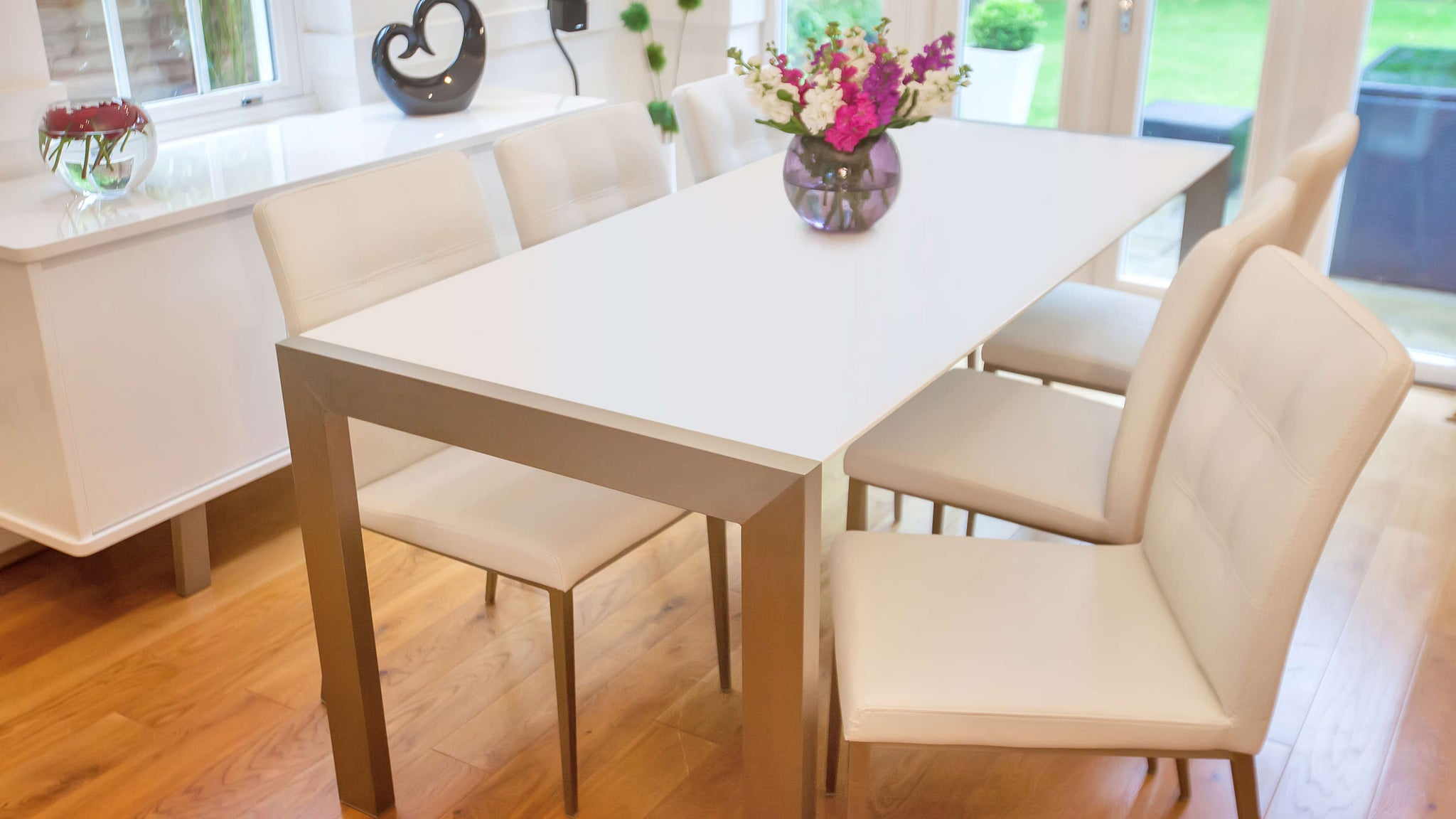 Modern White Leather Dining Chairs and Matt White Extending Table