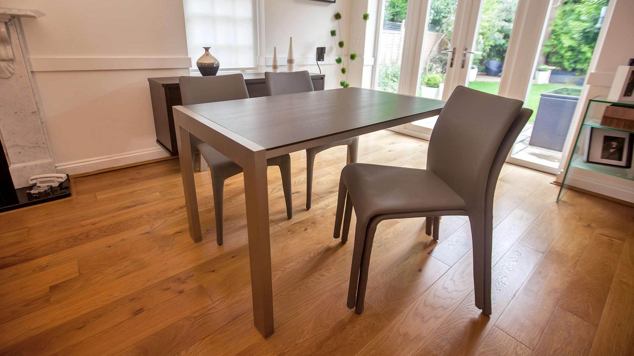 Dark Wood Extending Dining Table with Stackable Dining Chairs