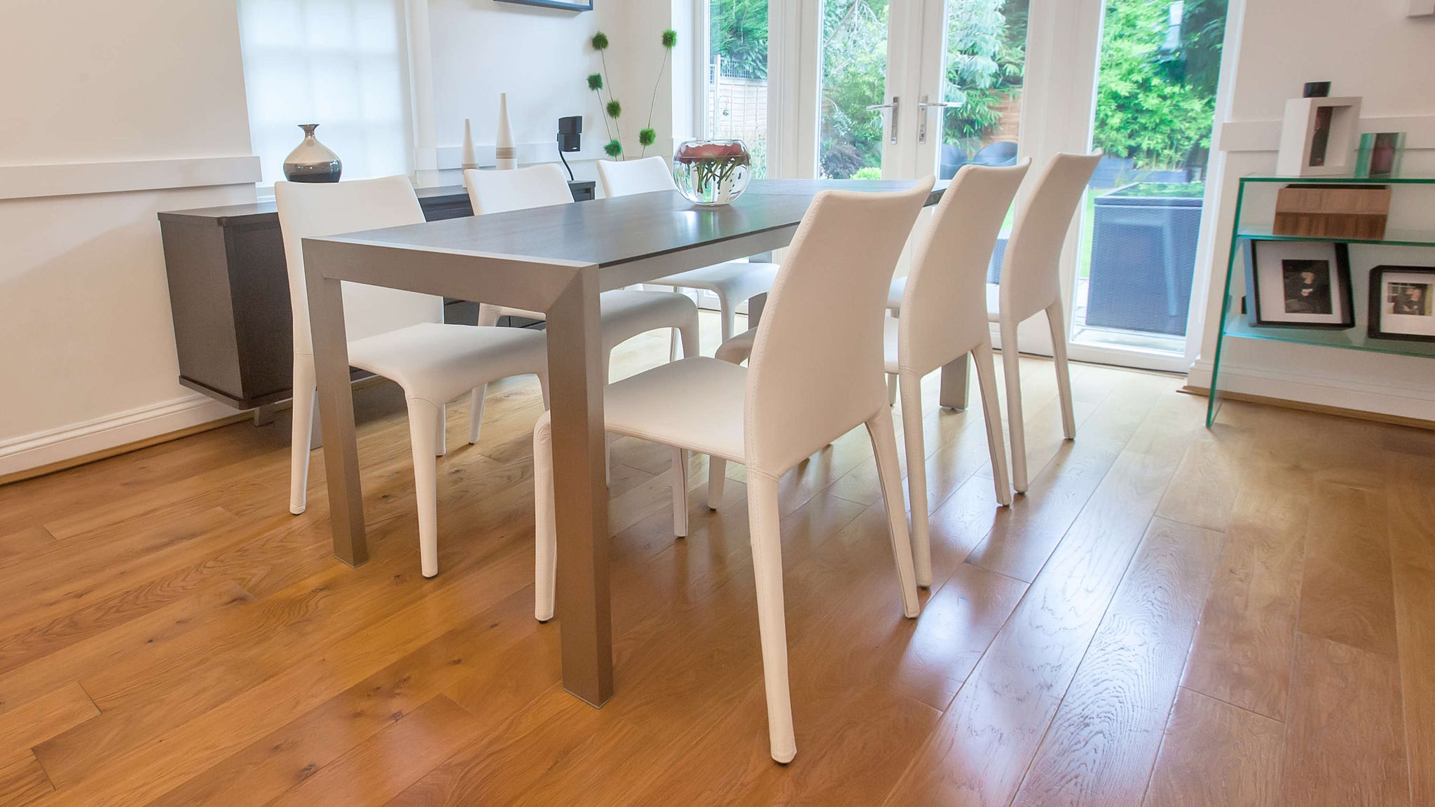 4-8 Seater Extending Dining Table and White Leather Dining Chairs