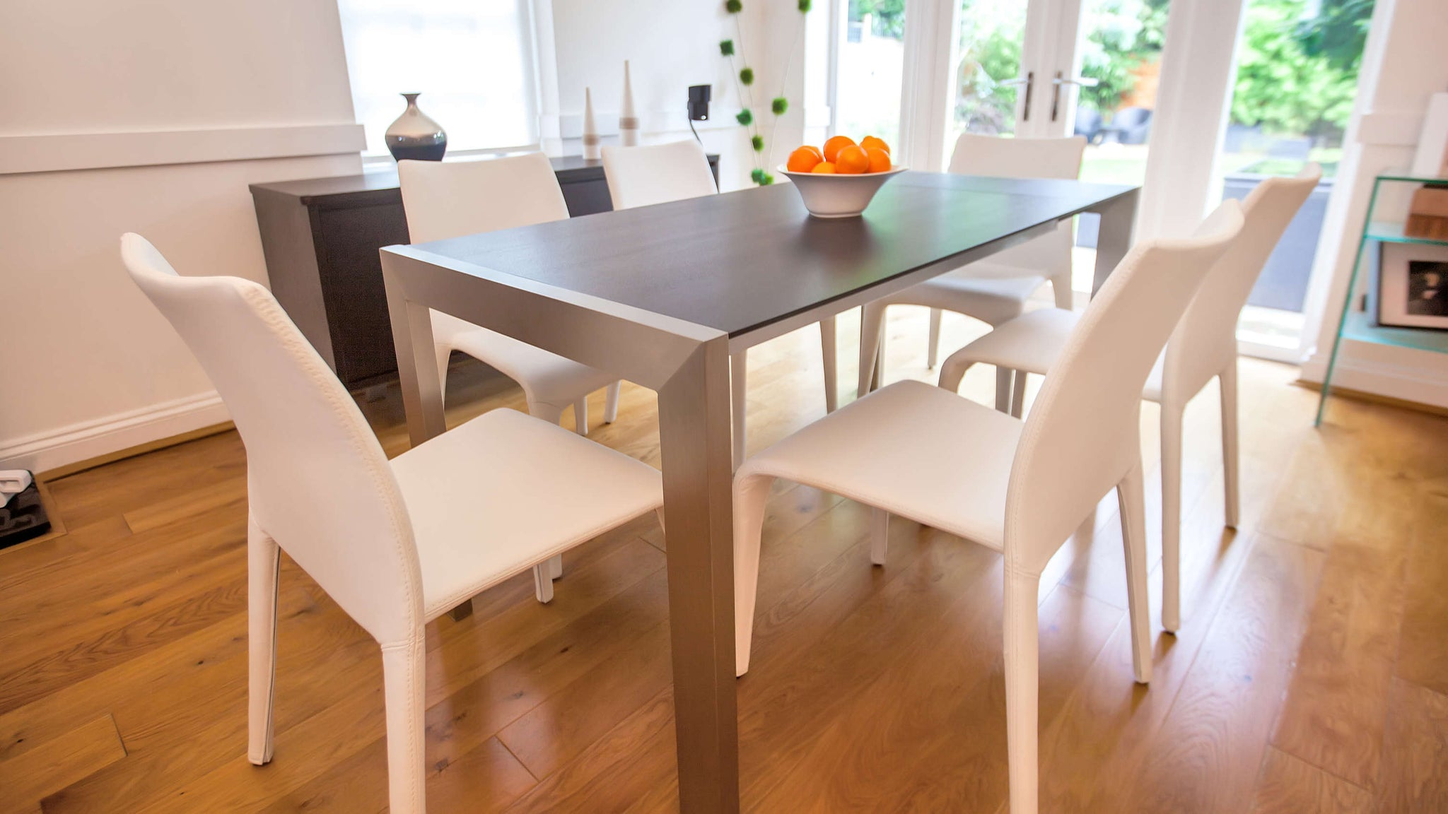 4-8 Seating Dining Table and White Faux Leather Dining Chairs