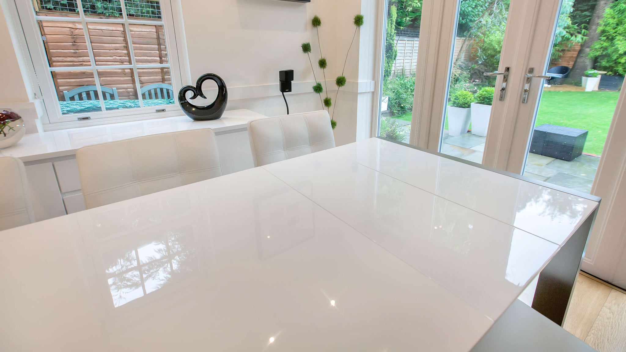 Glossy Double Extending Dining Table and White Chairs