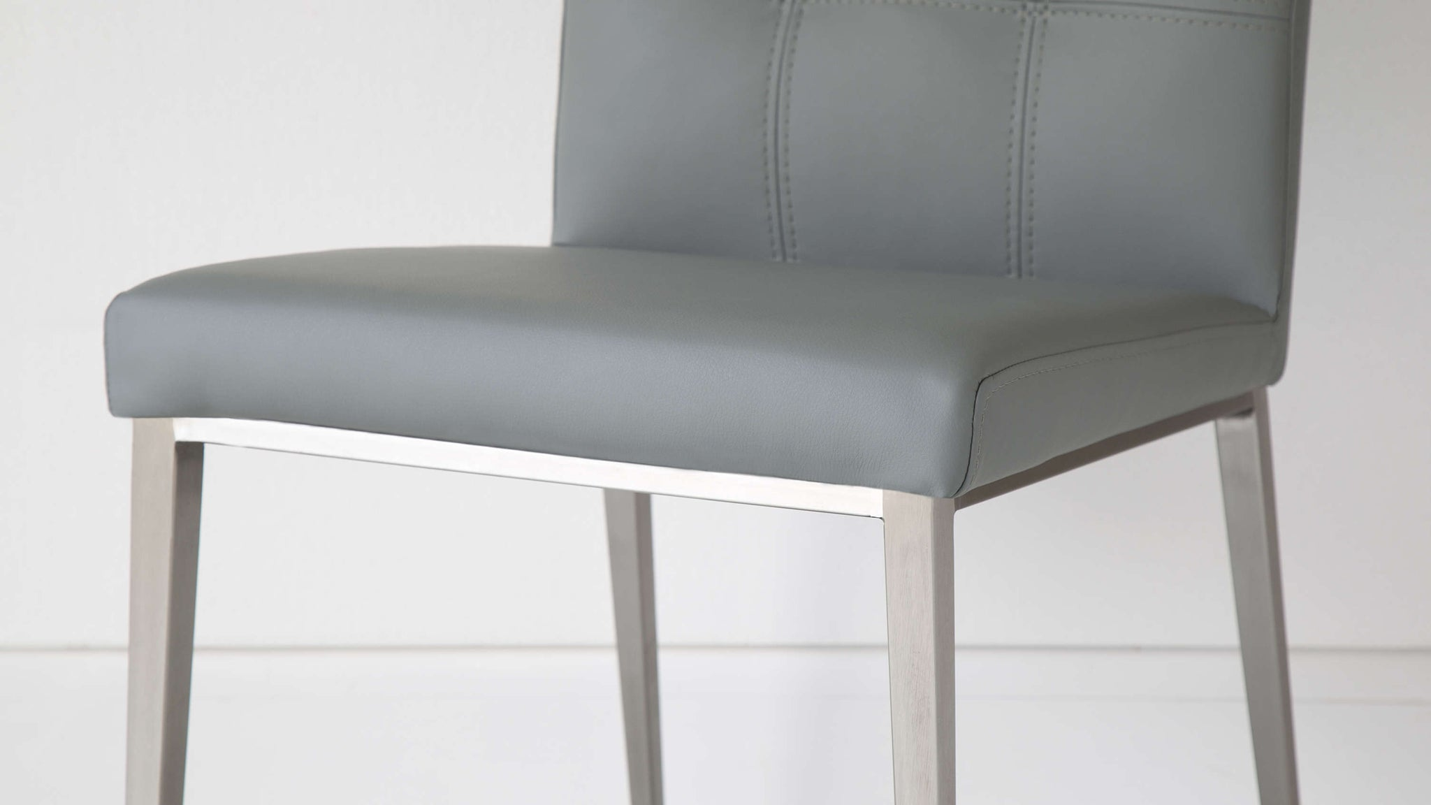 Grey Leather and Brushed Metal Legged Chairs